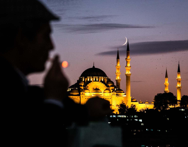 Fisherman over Galata Bridge, on the background Sulleymanye Mosque. Istanbul, Turkey - © Beniamino Pisati